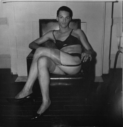 seated-man-in-a-bra-and-stocking.jpg