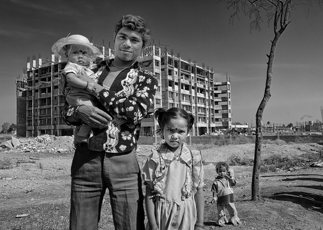 indian worker and family