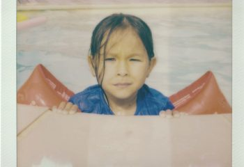 Little girl at the swimming pool