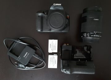 Canon 550D + 18-135mm  + 2 batteries + ...