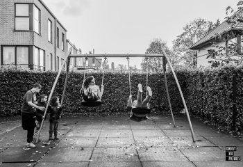 Happy kids swinging on playground